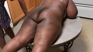 ebony girl gets a hard hand spanking on kitchen table