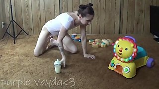 I play with my baby toys with my diaper on while sucking my bottle.