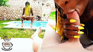 Tattooed ebony babe with perfect tits gives an outdoor blowjob at the pool