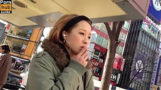 Japanese teen publicly smokes for 1st time- feels shame but needs the smoke