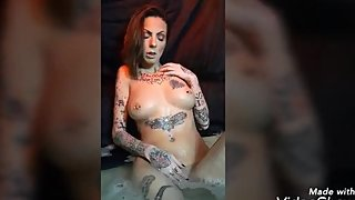 Molly Moth Fingers her wet pussy in the bathtub.