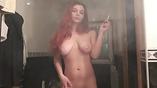 Smoking naked in front of camera