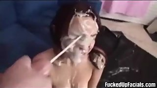 Covering Her Pretty Face With Cum