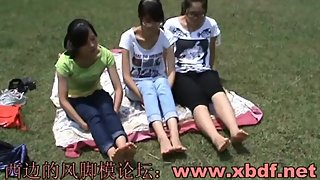 Three Chinese Teenagers' Barefeet In the Park