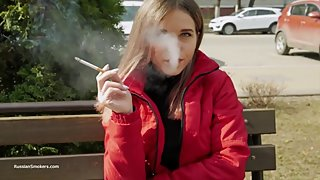 Cute Russian brunette smoking cork cigarette during interview